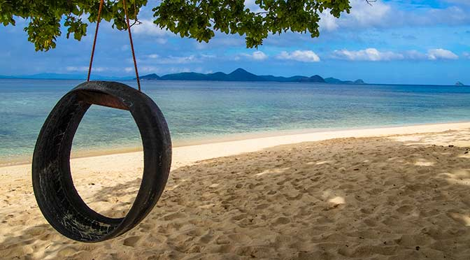 tire swing on secluded Philippine beach