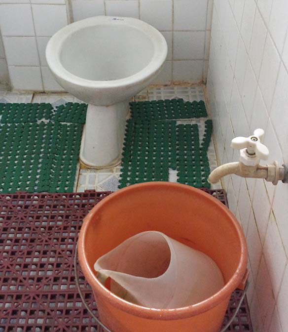 philippine toilet and bucket for manual flushing