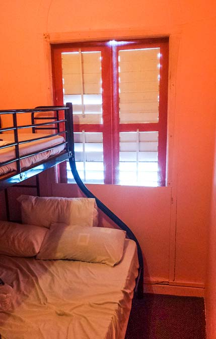 Pink hostel room in Singapore