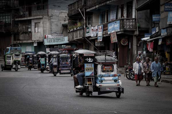 Philippine tricycles rule the roads.