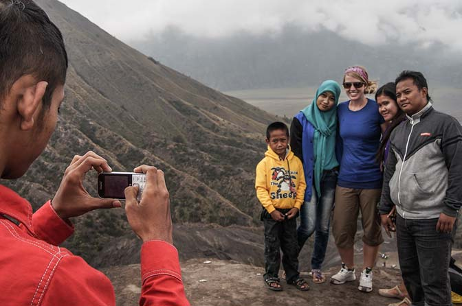 Picture with an Indonesian family on top of Mt. Bromo.