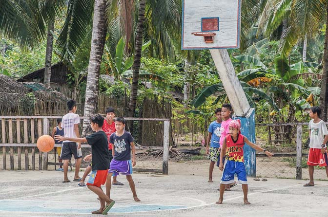 Local kids playing ball.