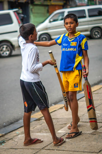 Local kids playing cricket on our street.
